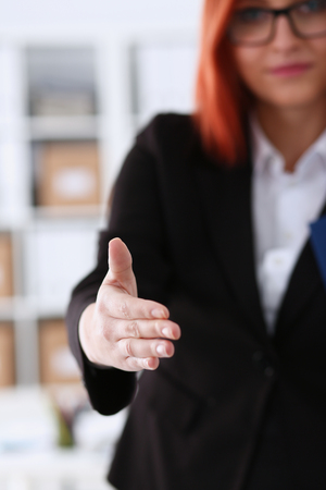 Businesswoman offer hand to shake as hello Stock Photo