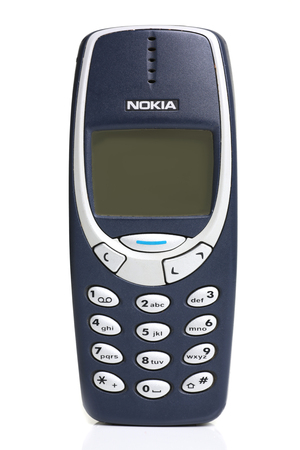 vintage phone nokia 3310 isolated on white Фото со стока - 92004956