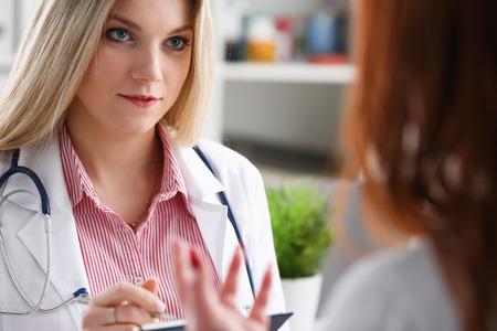 Smiling beautiful female medicine doctor explain