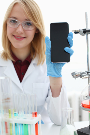 A female doctor in a chemical laboratory holds Stock Photo