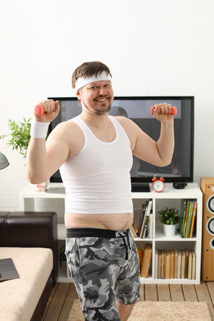 Young attractive man engaged in fitness Banque d'images
