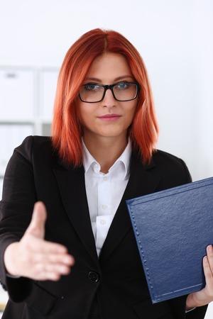 Businesswoman offer hand to shake as hello Stockfoto