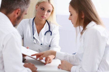 Female family doctor listen carefully young