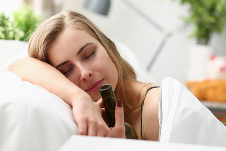 young woman wake up in the morning after night party Stock Photo