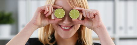 Female hands hold a cut fruit at eye level
