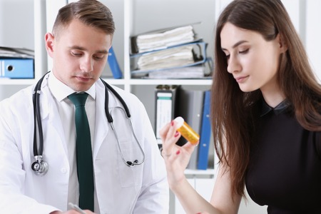 Handsome male doctor explain prescription while
