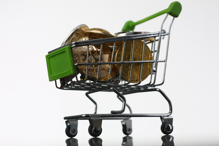 Basket from supermarket with coins crypto currency Stock Photo