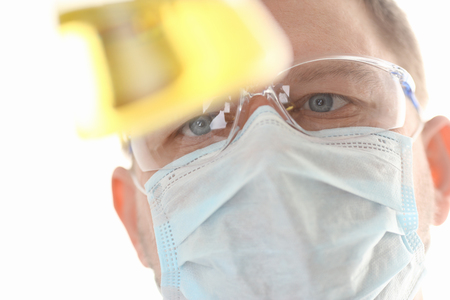 A portrait of a young surgeon chemist doctor