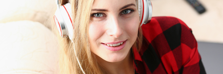 woman listen music headphones dream relax Reklamní fotografie