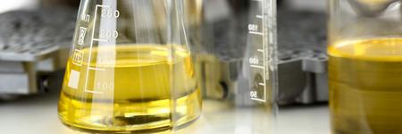 Test tube chemistry flask against background Stockfoto