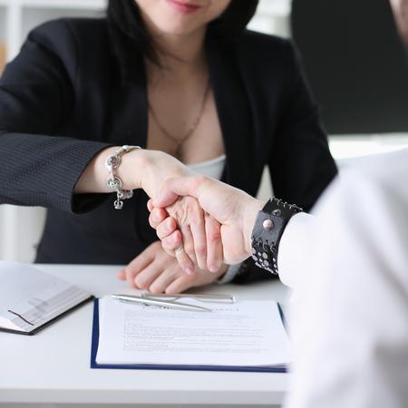 business partneers make handshake