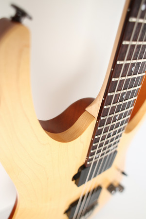 Classic shape wooden electric guitar with rosewood neck