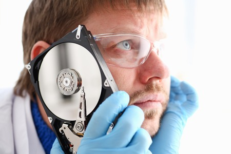 Repairman attached the hard drive of the Stock Photo