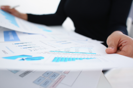 businesswoman study documents in office closeup
