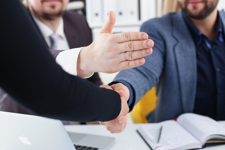 young happy businessmen have meeting in office argue with each other have different points of view Stock Photo