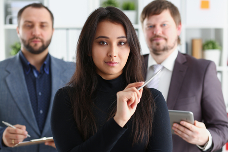 portrait of businesslady and two businessmen in office