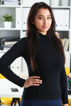 portrait of young beautiful brunette businesswoman work in office