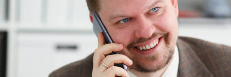 Handsome smiling businessman talk cellphone in office portrait. Stay in touch solution negotiate meeting job white collar busy life style electronic device store professional training concept Stok Fotoğraf