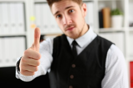 Male arm show OK or confirm during conference in office