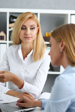 Young couple trying to get loan at bank clerk consultant