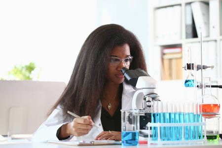Black woman scientist student chemist in protective