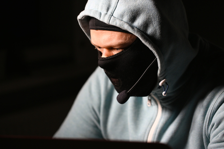 Man carder in mask connect to darknet Reklamní fotografie