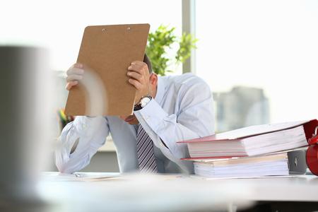 A man experiences stress and a headache Stok Fotoğraf