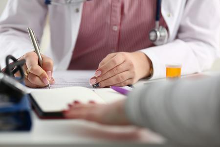Female medicine doctor hand hold jar of pills 写真素材