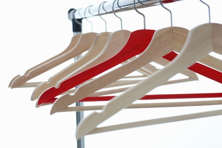 Red and wooden hanger hanging on metal