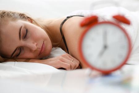 Young beautiful woman sleep well in the morning alarm Stock Photo