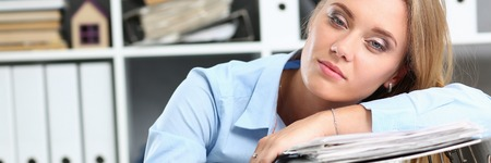 Lot of work wait for tired and exhausted woman