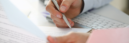 Hand of businessman in suit filling and