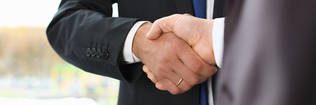 Man in suit shake hand as hello in office