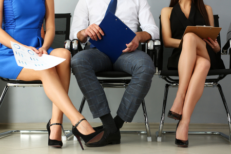 Legs and arms of group of people sit on casting
