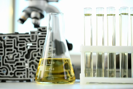 Test tube chemistry flask against background Stock Photo