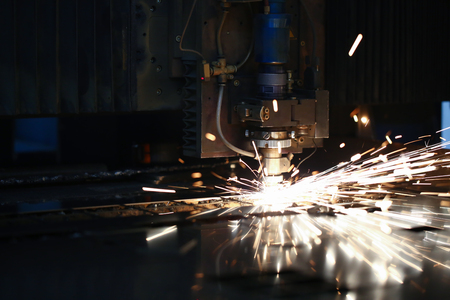 Sparks fly out machine head for metal processing Stockfoto