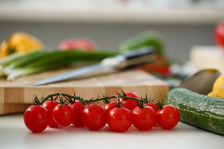 Cherry tomatoes lie on a cutting board