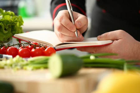 An open book of recipes on background Stockfoto