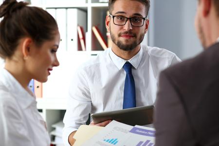 Handsome smiling bearded clerk man wearing glasses