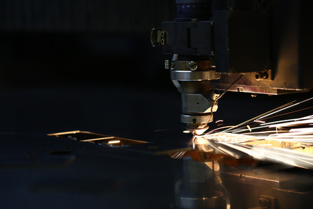 Sparks fly out machine head for metal processing Stock Photo