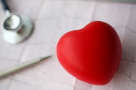 Medical stethoscope head and red toy heart Imagens