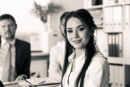 Beautiful smiling brunette clerk girl at workplace 写真素材