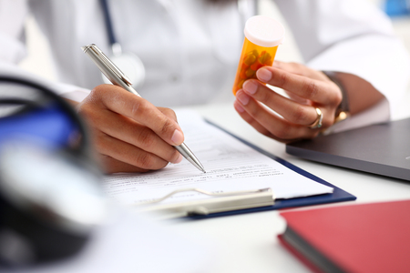 Female black medicine doctor hand hold jar