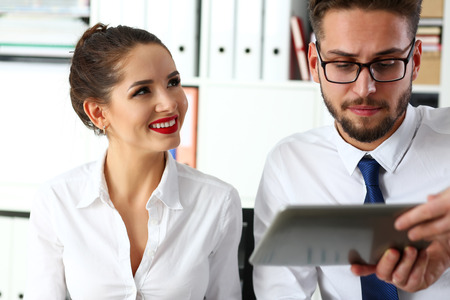 Group of coworkers use tablet pc in office portrait