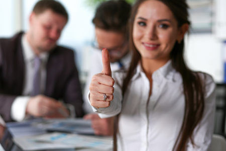 Female arm show OK or confirm during conference Stock Photo