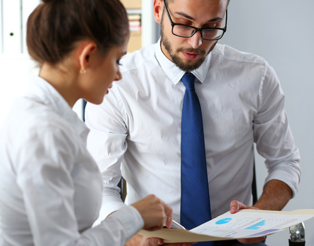 Group of modern businesspeople in office debate on financial issue Stock Photo