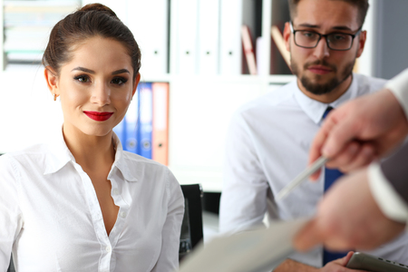 Beautiful smiling brunette clerk girl at workplace Stock Photo