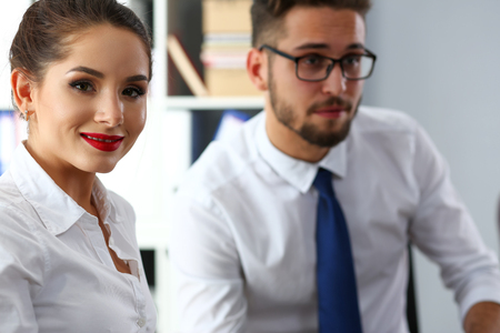 Beautiful smiling brunette clerk girl at workplace 免版税图像