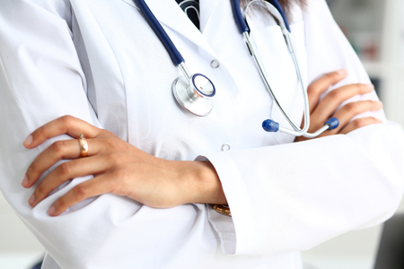 Female medicine doctor hands crossed 版權商用圖片