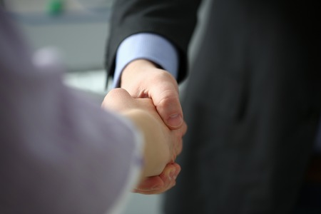 Man in suit and tie give hand as hello in office Stock fotó